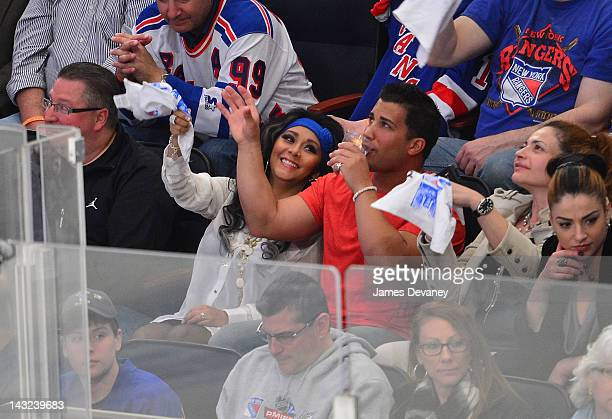 Nicole 'Snooki' Polizzi and Jionni LaValle attend the Ottawa Senators vs New York Rangers game at Madison Square Garden on April 21 2012 in New York...