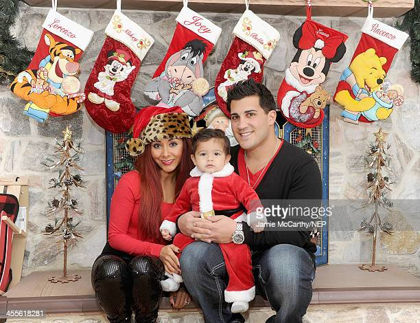 Nicole 'Snooki' Polizzi and Jionni LaValle celebrate the holidays with their son Lorenzo LaValle on December 12 2013 in Whippany New Jersey