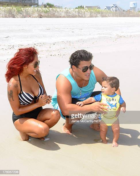 Nicole 'Snooki' Polizzi and Jionni LaValle enjoy a day at the beach with their son Lorenzo Dominic LaValle July 29 2013 in Jersey Shore New Jersey