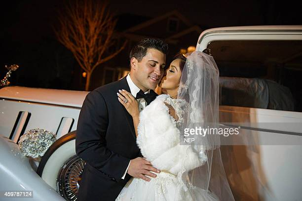 Nicole Snooki Polizzi and Jionni LaValle pose druign their wedding at St Rose Of Lima on November 29 2014 in East Hanover New Jersey Dress by Eve of...