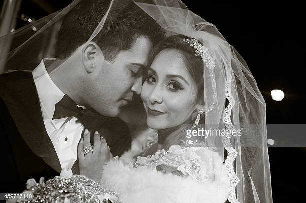 Nicole 'Snooki' Polizzi and Jionni LaValle pose druign their wedding at St Rose Of Lima on November 29 2014 in East Hanover New Jersey Head piece and...