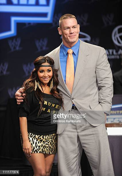 Nicole Snooki Polizzi and wrestler John Cena attend the WrestleMania XXVII press conference at the Hard Rock Cafe Times Square on March 30 2011 in...