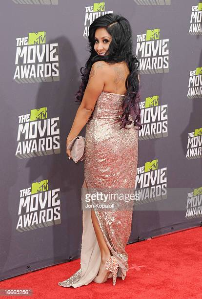 Nicole 'Snooki' Polizzi arrives at the 2013 MTV Movie Awards at Sony Pictures Studios on April 14 2013 in Culver City California