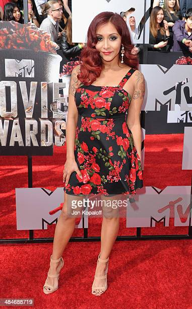 Nicole 'Snooki' Polizzi arrives at the 2014 MTV Movie Awards at Nokia Theatre LA Live on April 13 2014 in Los Angeles California