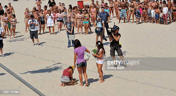 Nicole 'Snooki' Polizzi is helped back to the boardwalk by Jenni 'JWoww' Farley and Deena Nicole Cortese on July 30 2010 in Seaside Heights New Jersey