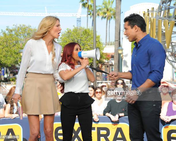 Nicole 'Snooki' Polizzi steals Brandi Glanville away from Mario Lopez at 'Extra' at Universal Studios Hollywood on February 19 2014 in Universal City...