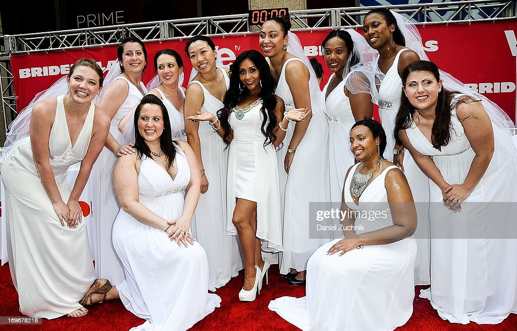 Nicole 'Snookie' Polizzi(C) and contestants attend the 'Bridezillas' Cake Eating Competition & WE TV's 10th Anniversary Celebration at Madison Square Garden on May 30, 2013 in New York City.