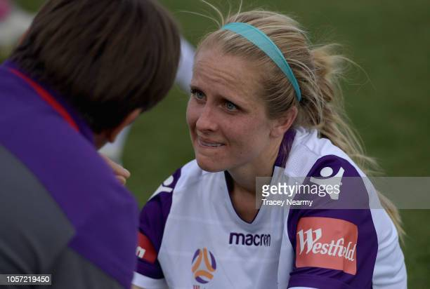 Nicole Stanton of Perth Glory speaks to their coach Bobby Despotovski of Perth Glory about her injured leg after the round two WLeague match between...