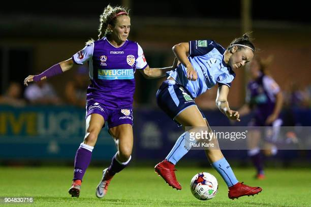 Nicole Stanton of the Perth Glory and Caitlin Foord of Sydney contest for the ball during the round 11 WLeague match between the Perth Glory and...