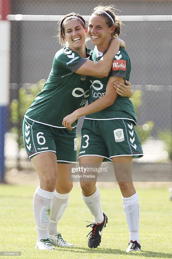 Nicole Sykes is congratulated by Caitlin Munoz of Canberra United after scoring a goal during the round eight W-League match between Canberra United and the Newcastle Jets at Deakin Football Stadium on December 8, 2012 in Canberra, Australia.