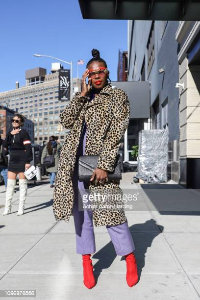 Nicole Thurman is seen weating a leopard print Forever 21 coat Don The Junkman sunglasses and red Ego shoes on the street during New York Fashion...