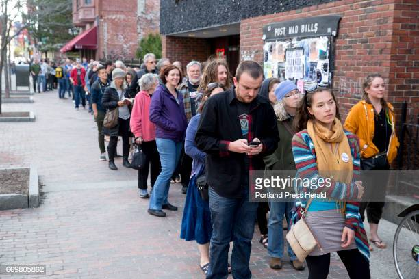 Nicole Trudel of Portland from left waits in line to get into the State Theatre to see Bernie Sanders speak at the Come Together and Fight Back tour...