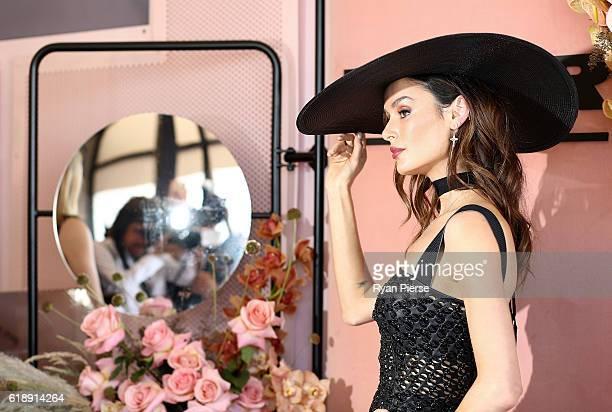 Nicole Trunfio poses at the Myer Marquee on Derby Day at Flemington Racecourse on October 29 2016 in Melbourne Australia
