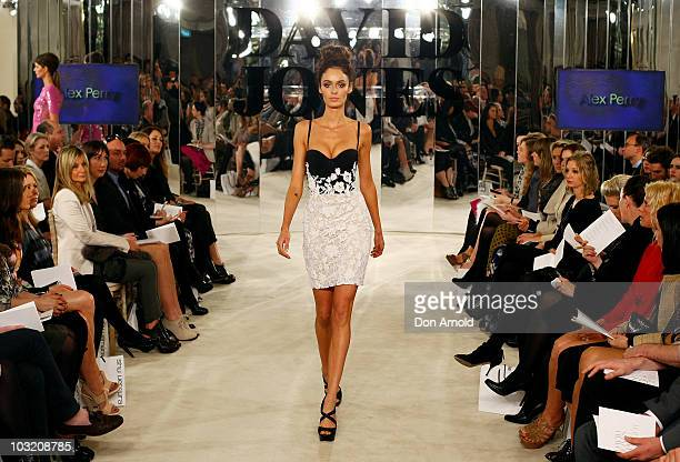 Nicole Trunfio wears designs by Alex Perry on the catwalk for the David Jones Spring/Summer Season launch at David Jones Elizabeth St Store on August...