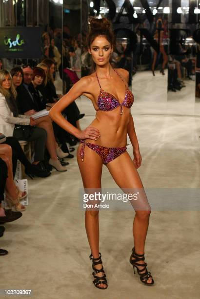 Nicole Trunfio wears designs by Isola on the catwalk during the David Jones Spring/Summer 2010 Season Launch at David Jones Elizabeth Street Store on...