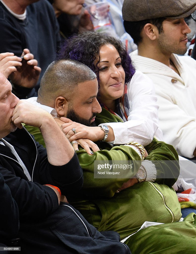 Nicole Tuck (R) and DJ Khaled attend a basketball game between the Miami Heat and the Los Angeles Clippers at Staples Center on January 13, 2016 in Los Angeles, California.