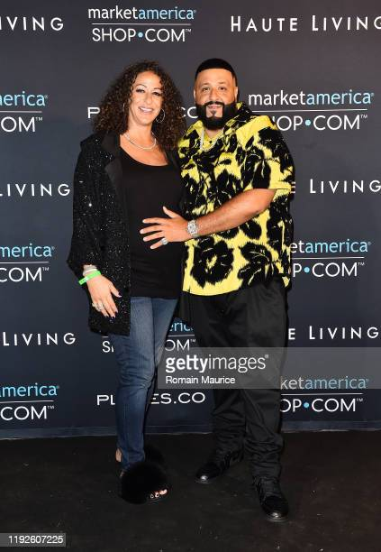 Nicole Tuck and DJ Khaled attend SHOPCOM Haute Living's celebration of the release of Family Ties Fat Joe's newest last album at the Ridinger Estate...