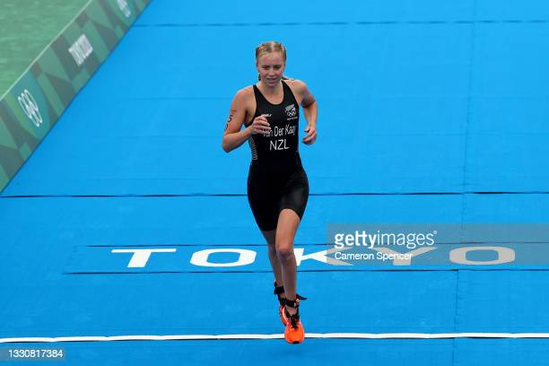 Nicole van der Kaay of Team New Zealand crosses the finish line during the Women's Individual Triathlon on day four of the Tokyo 2020 Olympic Games...
