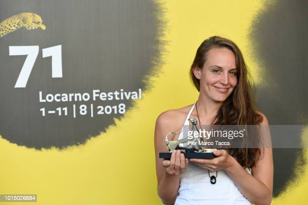 Nicole Vogele poses with Pardo of Special Jury Prize of Filmmakers of the Present Competition at the Palmares photocall during the 71st Locarno Film...
