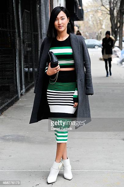 Nicole Warne is seen outside the Thakoon show wearing a Shop Bop dress on February 9, 2014 in New York City.