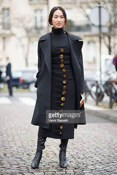 Nicole Warne poses after the Miu Miu show at Place de Iena during Paris Fashion Week FW 16/17 on March 9 2016 in Paris France