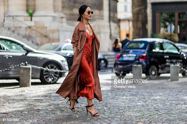 Nicole Warne wearing a silk dress and coat and sandals outside Lanvin on September 28 2016 in Paris France