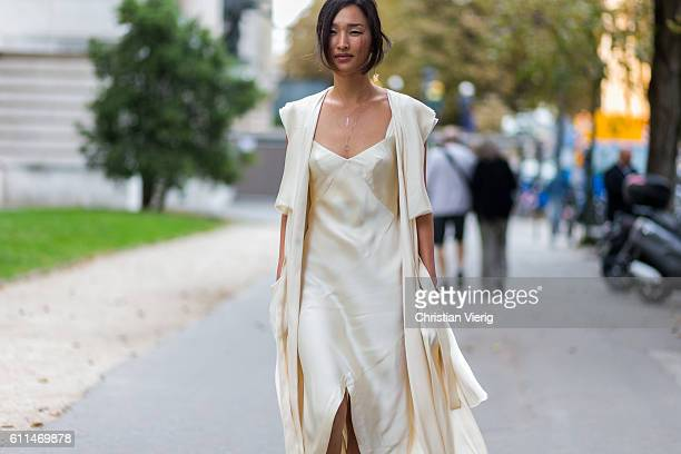 Nicole Warne wearing a silk dress and sandals outside Chloe on September 29 2016 in Paris France