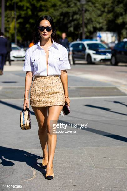 Nicole Warne wearing a white shirt Chanel beige skirt Chanel heels and Chanel straw bag is seen outside Chanel show during Paris Fashion Week Haute...