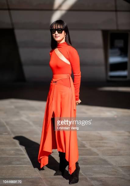 Nicole Warne wearing orange dress is seen outside Giambattista Valli during Paris Fashion Week Womenswear Spring/Summer 2019 on October 1 2018 in...