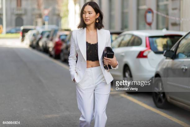 Nicole Warne wearing white suit black laced cropped top outside Dolce Gabbana during Milan Fashion Week Fall/Winter 2017/18 on February 26 2017 in...