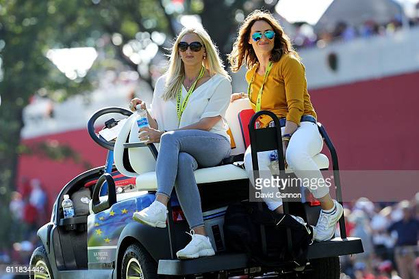 Nicole Willett and Helen Storey sit on a cart near the eighth tee during afternoon fourball matches of the 2016 Ryder Cup at Hazeltine National Golf...