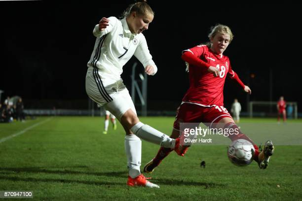 Nicole Woldmann of Germany and Mathilde Rasmussen of Denmark compete for the ball during the U16 Girls international friendly match betwwen Denmark...