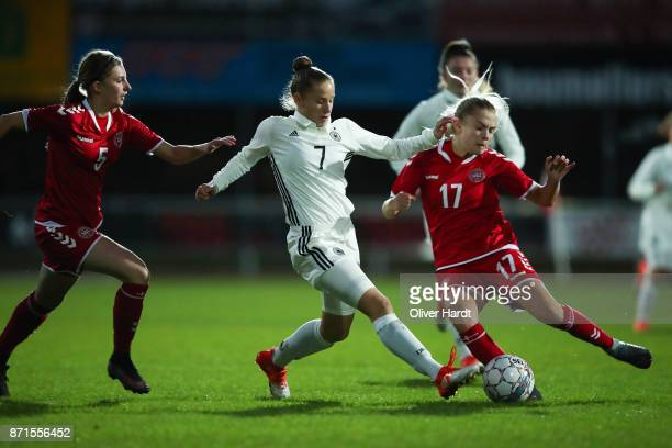 Nicole Woldmann of Germany and Sofie Lundgaard of Denmark compete for the ball during the U16 Girls international friendly match betwwen Denmark and...