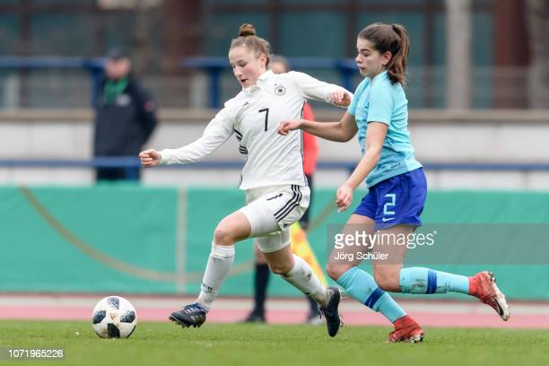 Nicole Woldmann of Germany battles for the ball with Zaina Bouzerrade of Netherlands during the U17 Girl's international friendly match between...