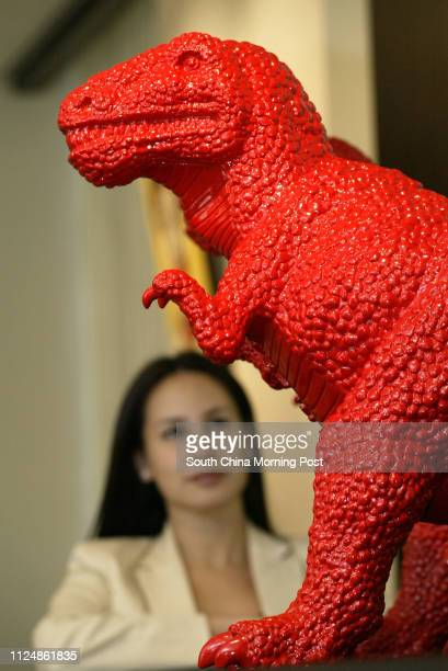 Nicole Wright Assistant Vice president Business Manager Asian Art Departments of Christie's shows Dinosaurs 3 cololur polysturene sculptures by Sui...
