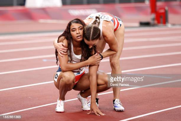 Nicole Yeargin and Emily Diamond of Team Great Britain reacts after finishing in fifth in the Women's 4 x 400 Relay on day fifteen of the Tokyo 2020...
