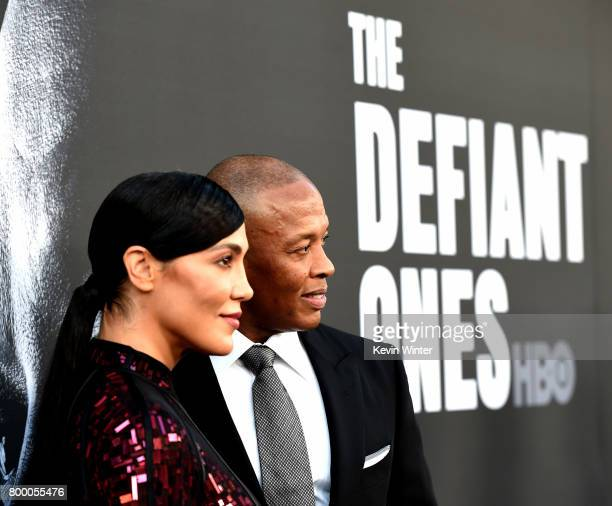 Nicole Young and producer Dr Dre arrive at the premiere screening of HBO's The Defiant Ones at Paramount Studios on June 22 2017 in Los Angeles...