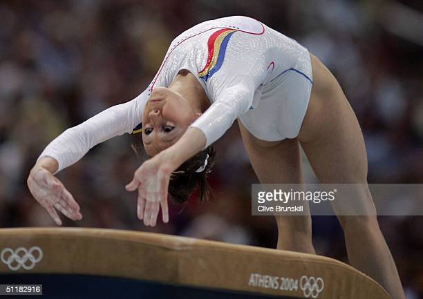 Nicoleta Daniela Sofronie of Romania competes on the vault at the women's artistic gymnastics team final uneven on August 17 2004 during the Athens...