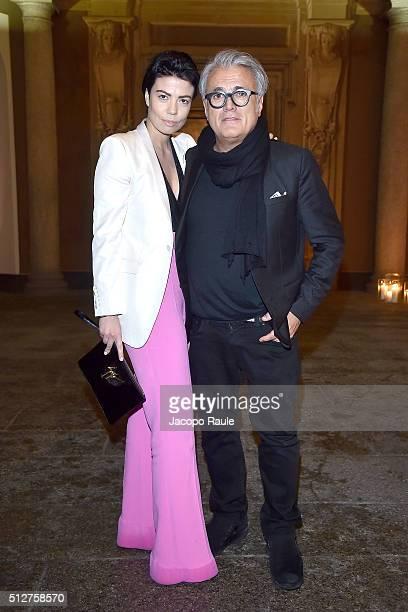 Nicoletta Ermeti and Giuseppe Zanotti attend Vogue Cocktail Party honoring photographer Mario Testino on February 27 2016 in Milan Italy