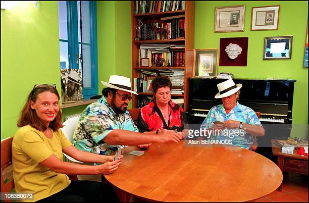 Nicoletta Luciano Pavarotti his sister Gabriella and his father Fernando playing cards in Pesaro Italy on August 20 2001