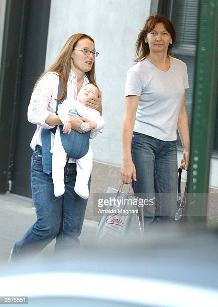 Nicoletta Mantovani, companion of opera singer Luciano Pavoritti, and their daughter Alice walk on Central Park South September 23, 2003 in New York...