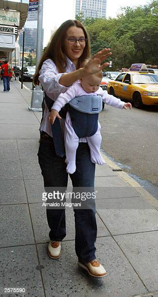 Nicoletta Mantovani companion of opera singer Luciano Pavoritti and their daughter Alice walk on Central Park South September 23 2003 in New York...