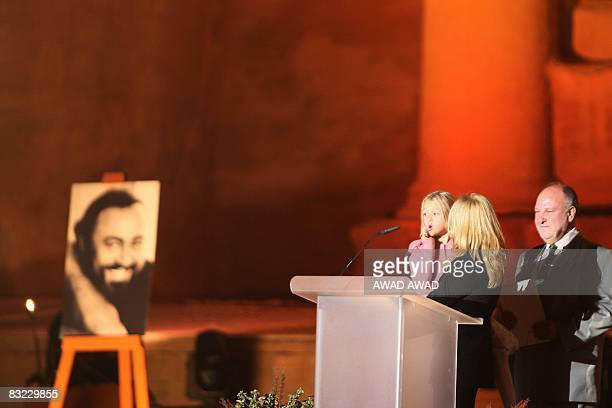 Nicoletta Mantovani Pavarotti , wife of the late Italian Maestro Luciano Pavarotti, holds their doughter Alice at the historic royal tomb called the...