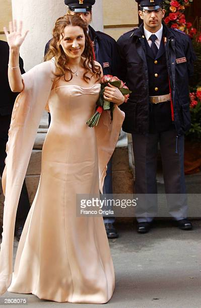 Nicoletta Mantovani waves as she arrives at the Teatro Comunale for her wedding to Opera star Luciano Pavarotti December 14 2003 in Italy