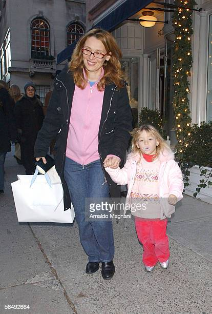 Nicoletta Mantovani-Pavarotti and three-year-old daughter, Alice, walk along Madison Avenue December 27, 2005 in New York City.