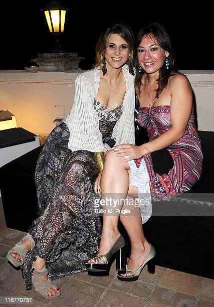 Nicoletta Romanoff and Costanza D'Ardia attend a cocktail party hosted by the Lancia Cafe during the 57th Taormina Film Fest on June 17 2011 in...
