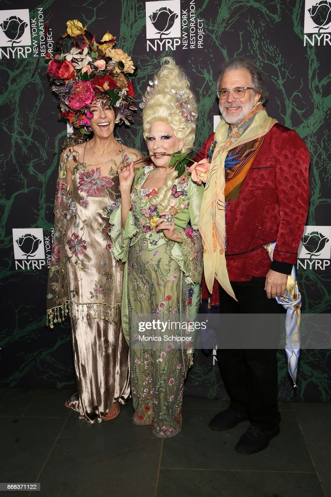 Nicolette Donen, Bette Midler and Clifford Ross attend Bette Midler's 2017 Hulaween event benefiting the New York Restoration Project at Cathedral of St. John the Divine on October 30, 2017 in New York City.