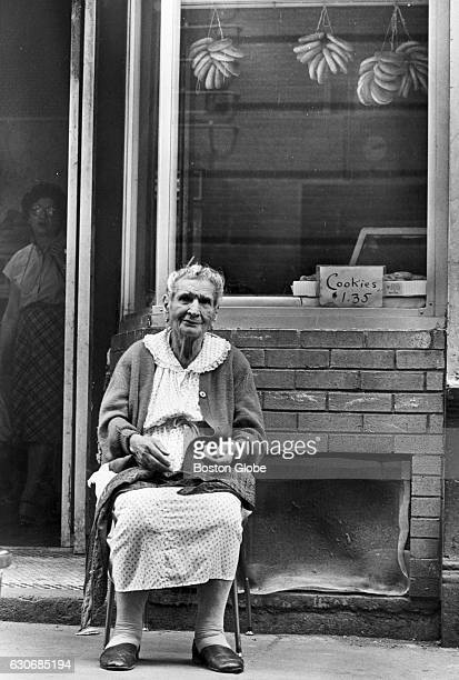 Nicolina Russo watches the world go by outside her daughter's store in Boston's North End on July 11 1980