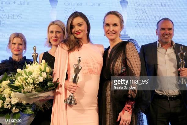 Nicoline Woehrle , Kerstin Unger , beauty idol Miranda Kerr, Editor-in-chief Gala Anne Meyer-Minnemann and winner Guenther Bonin pose with their...