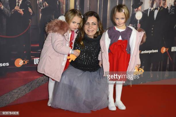 Nicolle Loehr with her daughters Smilla Loehr and Alma Loehr during the premiere of 'Ku'damm 59' at Cinema Paris on March 7 2018 in Berlin Germany